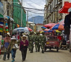 Tibetan street scene with soldiers