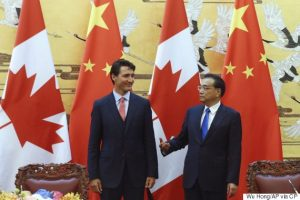 Chinese Premier Li Keqiang, right, and Canadian Prime Minister Justin Trudeau, left, attend a ceremony of signing agreement at the Great Hall of the People in Beijing, China, Wednesday, Aug. 31, 2016. (Wu Hong/Pool Photo via AP)